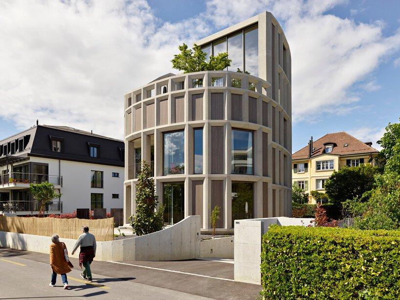 immeuble résidentiel incurvé par LOCALARCHITECTURE privilégie la vue sur le lac léman en suisse